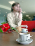 sad woman sitting at the café poster