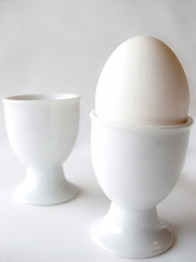 one white egg - two white egg cups