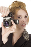 beautiful young woman with digital camera poster