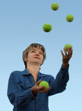 young woman juggling with tennis balls poster