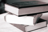 a stack of books poster