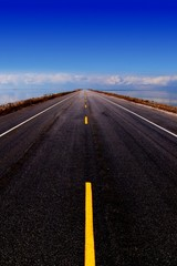 empty road stretching into distance