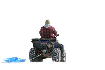 atv on snow pulling sled
