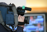 cameraman and newscast poster