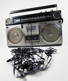 tape spewing boombox poster