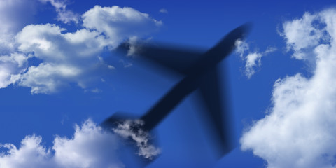 black airplane and blue sky and clouds
