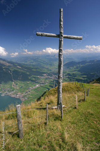 poster of cross on top of mountain