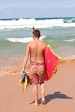 bodyboarder walking on the beach poster