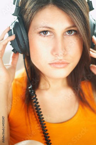 poster of sexy girl with headphones close up
