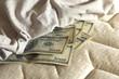 money under the mattress