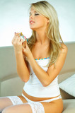 woman spraying perfume poster
