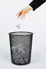 hand throwing paper trash