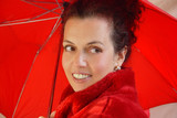 attractive middleaged woman with red umbrella poster