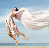 woman jumping on the beach poster