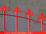 detail of a red iron gate poster