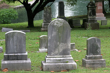 gravestones by lake