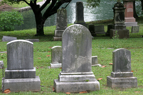 gravestones by lake - 458582