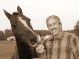 farmer feeds horse poster