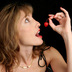 beautiful woman holding cherry