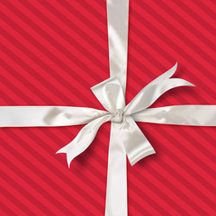 red striped gift with white satin ribbon