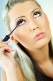 girl doing makeup poster