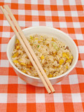 bowl with chinese rice on a table poster