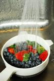 washing berries poster