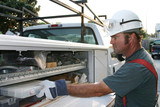 electrician with service truck poster