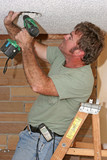 electrician with drill poster
