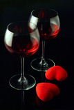 wine glasses and a two hearts poster