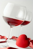 wine glasses and a heart poster