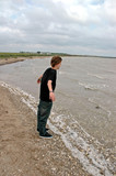 teen at the windy shoreline
