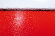 close up of side of glass with rose wine