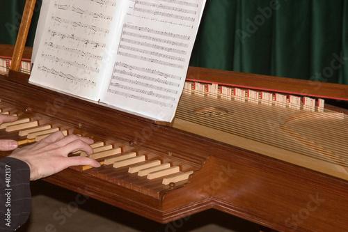 Leinwandbild Motiv playing on the clavecin