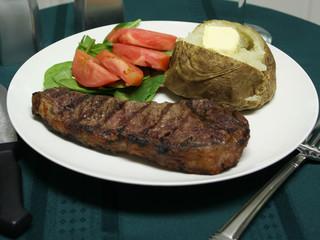 grilled steak dinner with utensils