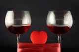 wine glasses wrapped with tape and heart poster