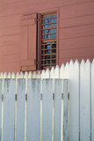 white fence and red walls poster