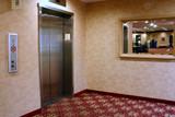 hotel elevator near lobby poster
