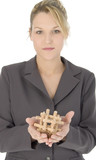 beautiful blonde business woman with wooden puzzle poster