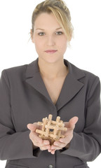 beautiful blonde business woman with wooden puzzle