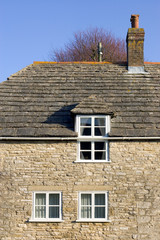 traditional stone clad house in corfe, dorset