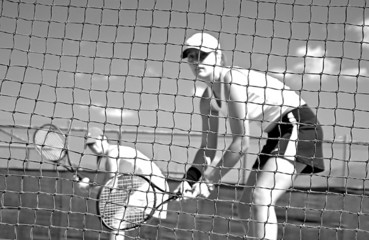 woman tennis players looking at camera through net waiting to pl