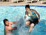 2 kids having good time in the swimming pool poster