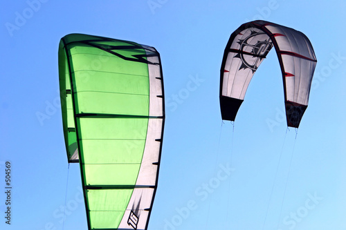 kitesurfing kites against a blue sky