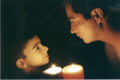 father and son by candle light