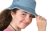 girl tipping hat poster