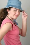 stylish girl tips hat poster