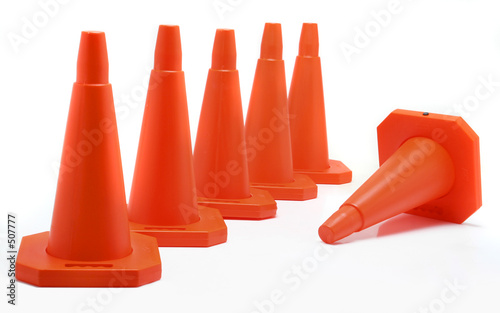 poster of five cones aligned, one fall down
