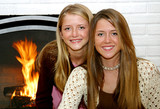 sisters by the fireside poster