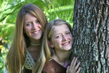 teen sisters by tree poster